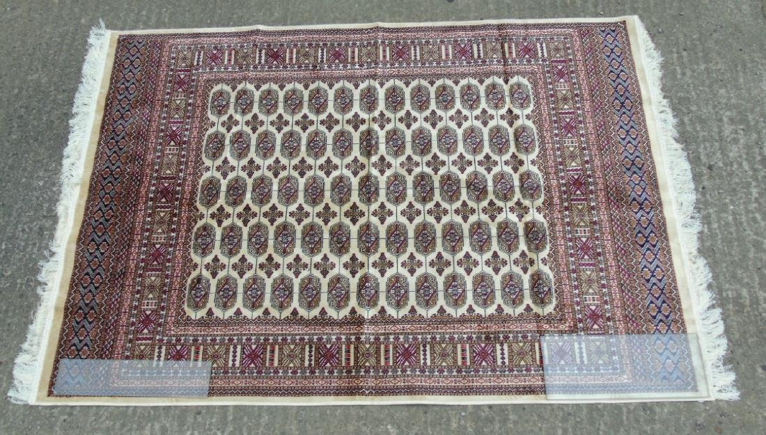 Rug Carpet : A late 20 thC machine made Bokhara rug