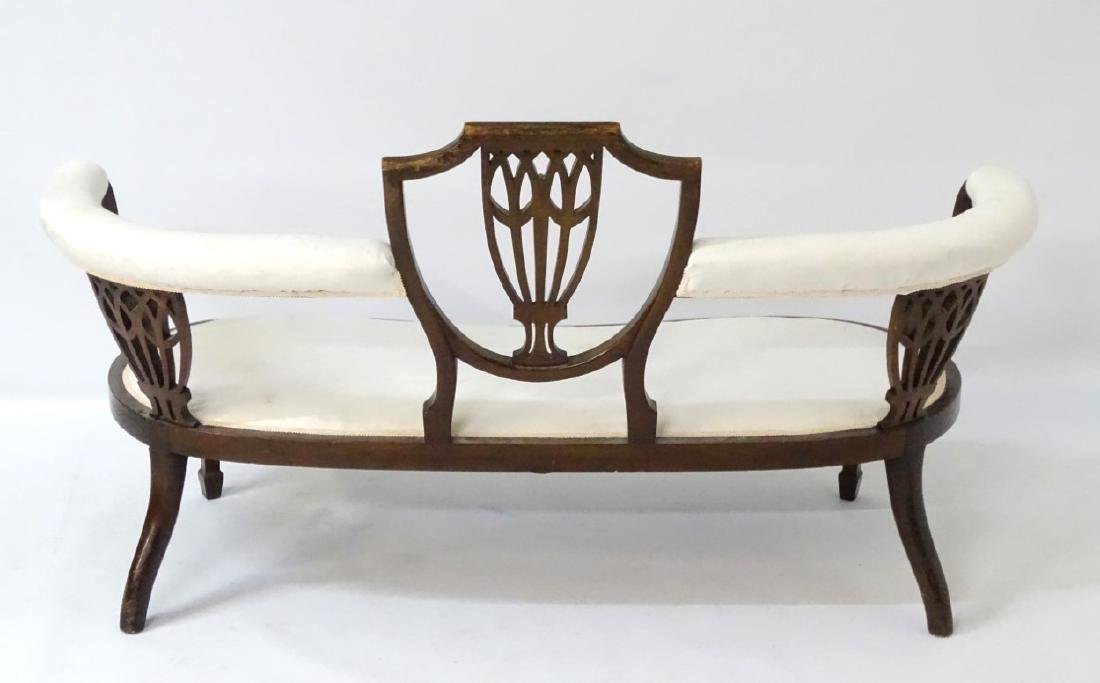 An early 20thC conversational sofa with curved - 2