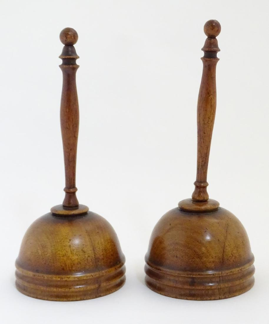 A pair of 19thC walnut cups from a ball and cup game. - 2