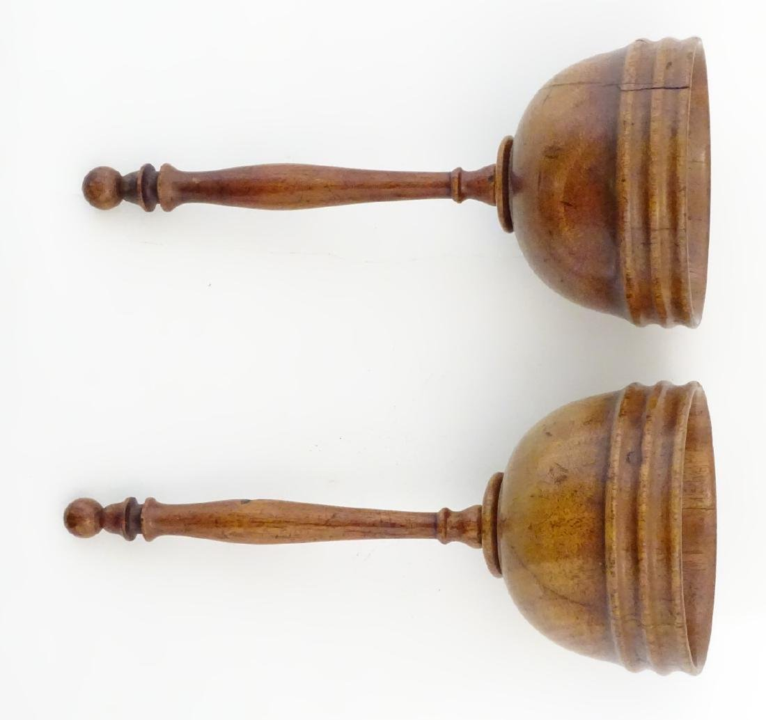 A pair of 19thC walnut cups from a ball and cup game. - 4