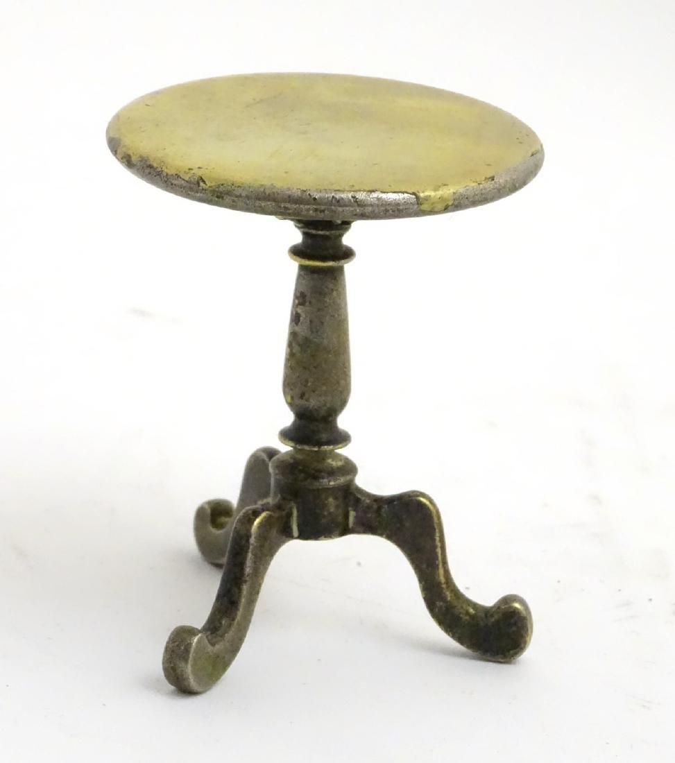A late 19thC / early 20thC cast brass miniature tripod