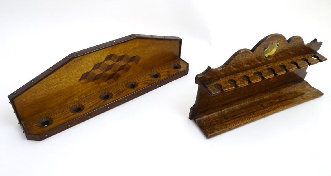 Pipe smoking: An early 20thC oak pipe rack, with - 2