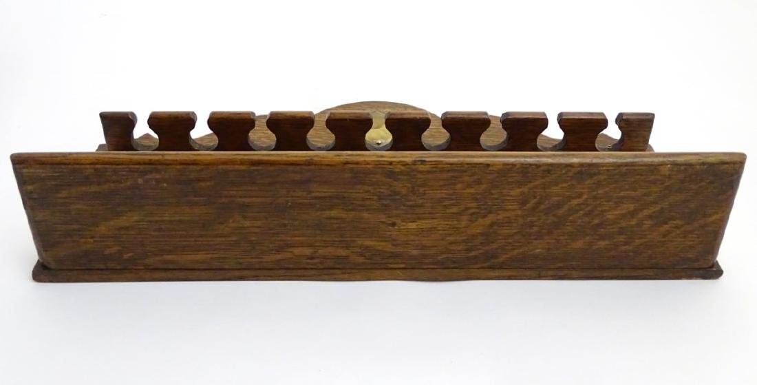 Pipe smoking: An early 20thC oak pipe rack, with - 3