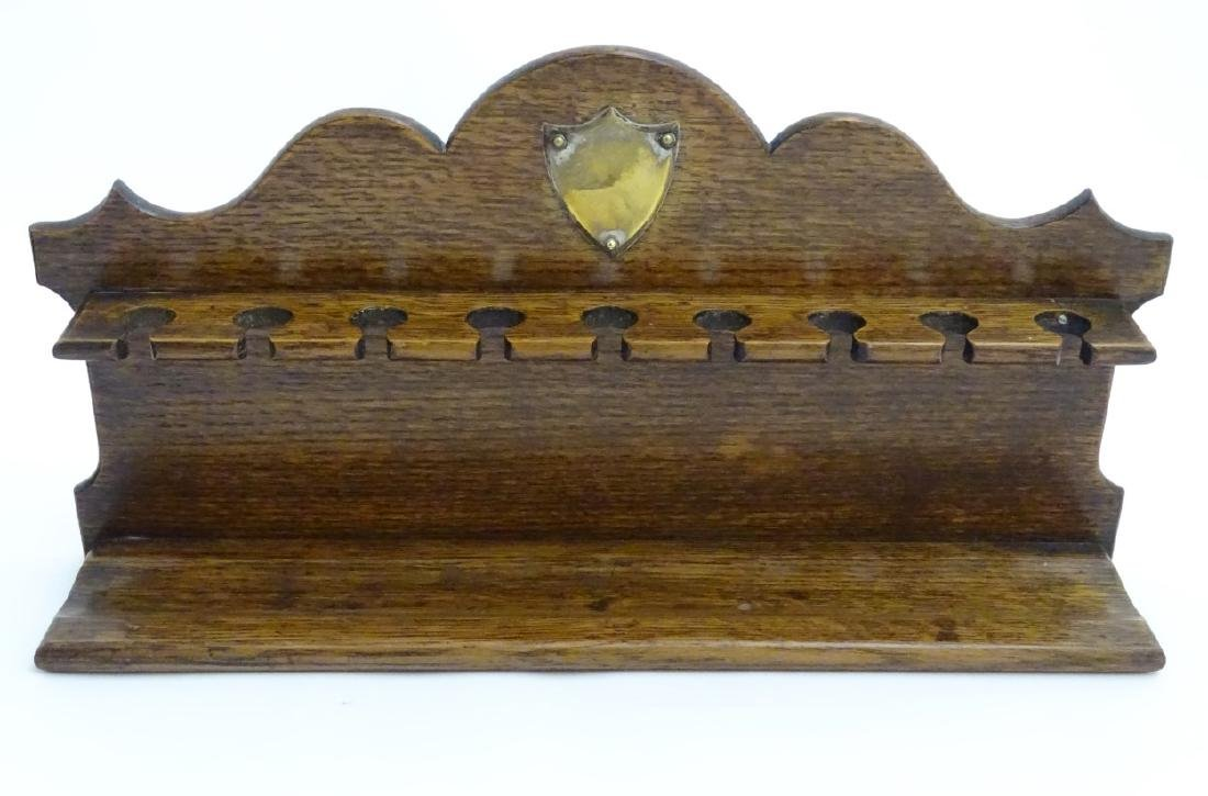 Pipe smoking: An early 20thC oak pipe rack, with - 9