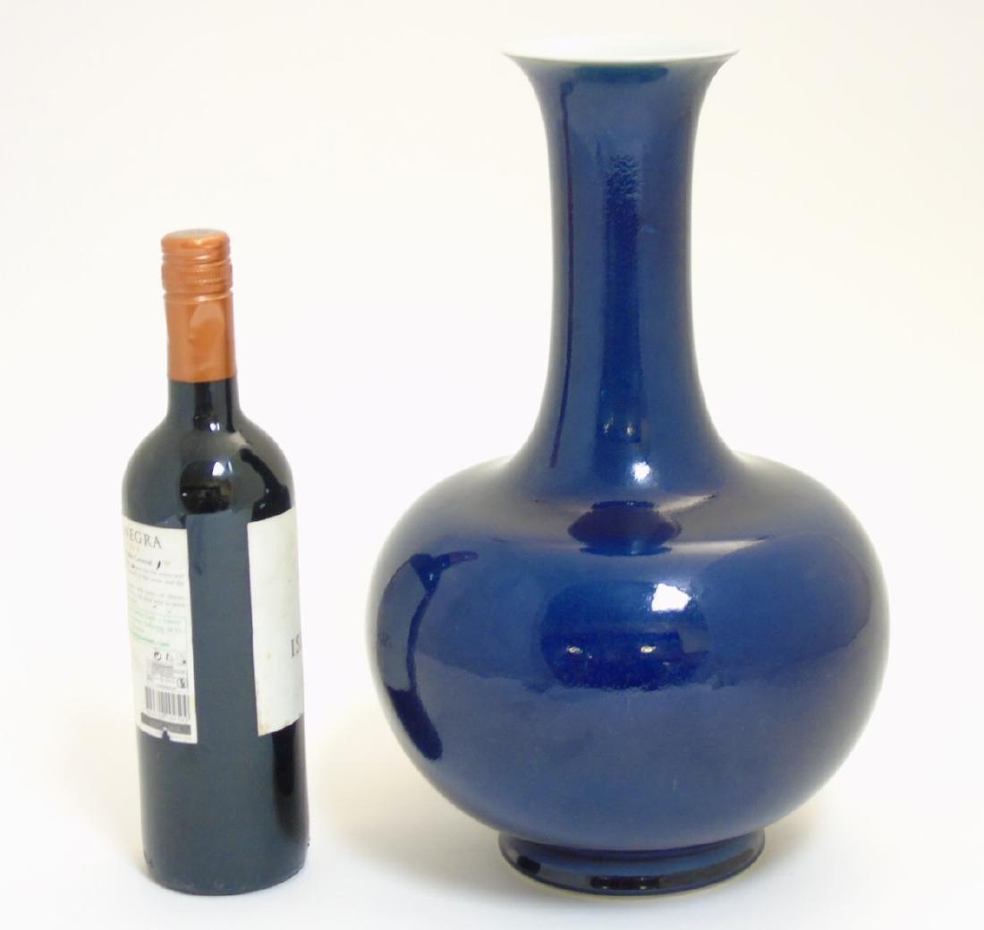 A Chinese blue monochrome Shangping vase with globular