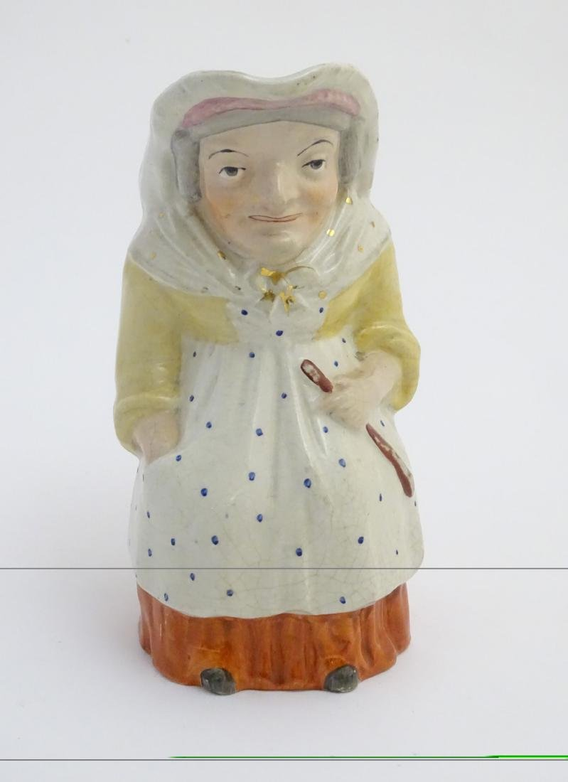 A 19thC Staffordshire Toby jug formed as the character