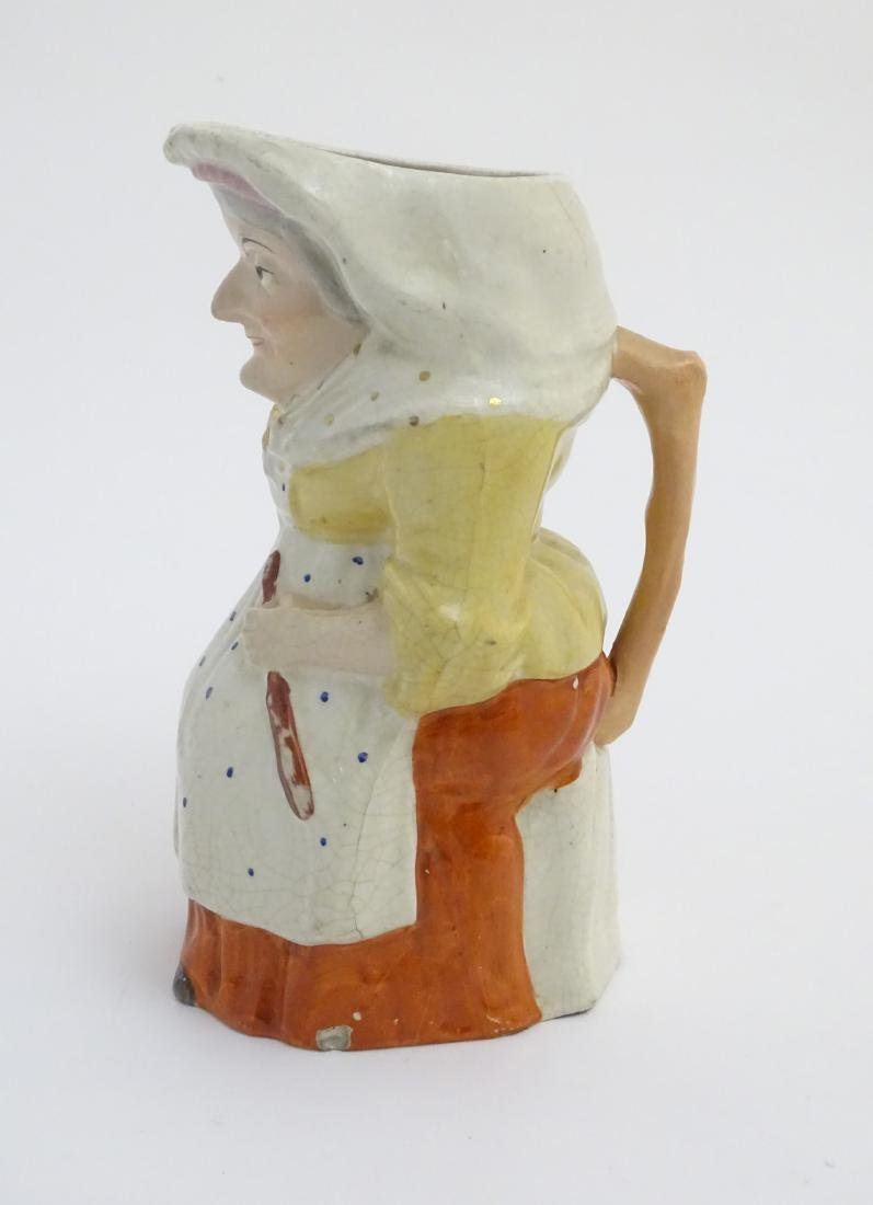 A 19thC Staffordshire Toby jug formed as the character - 3
