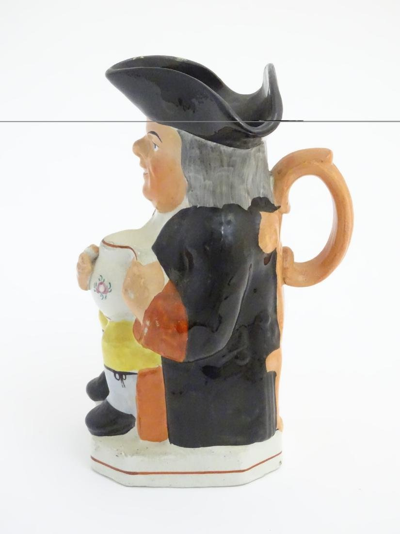 A 19thC Staffordshire Toby jug formed as a man seated - 3