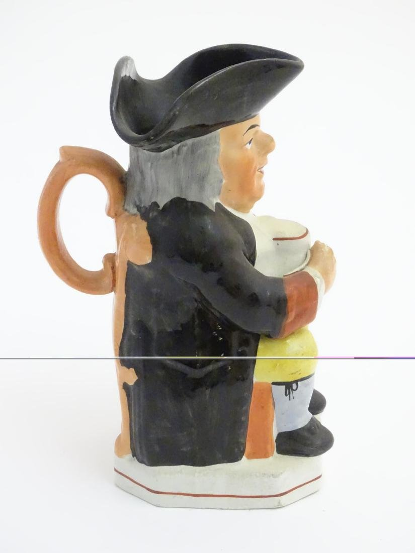 A 19thC Staffordshire Toby jug formed as a man seated - 5