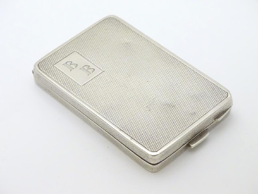 A silver compact case of rectangular form hallmarked