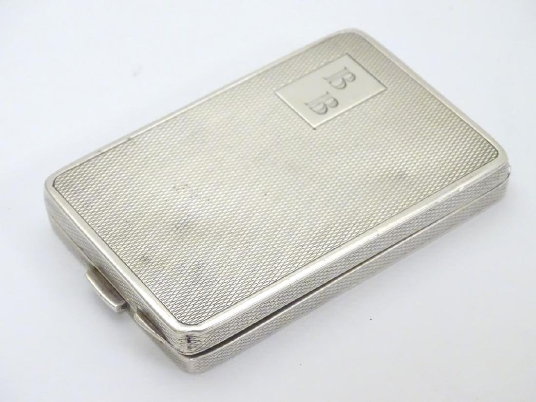 A silver compact case of rectangular form hallmarked - 3