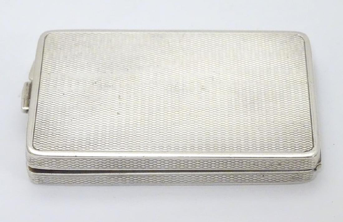 A silver compact case of rectangular form hallmarked - 4