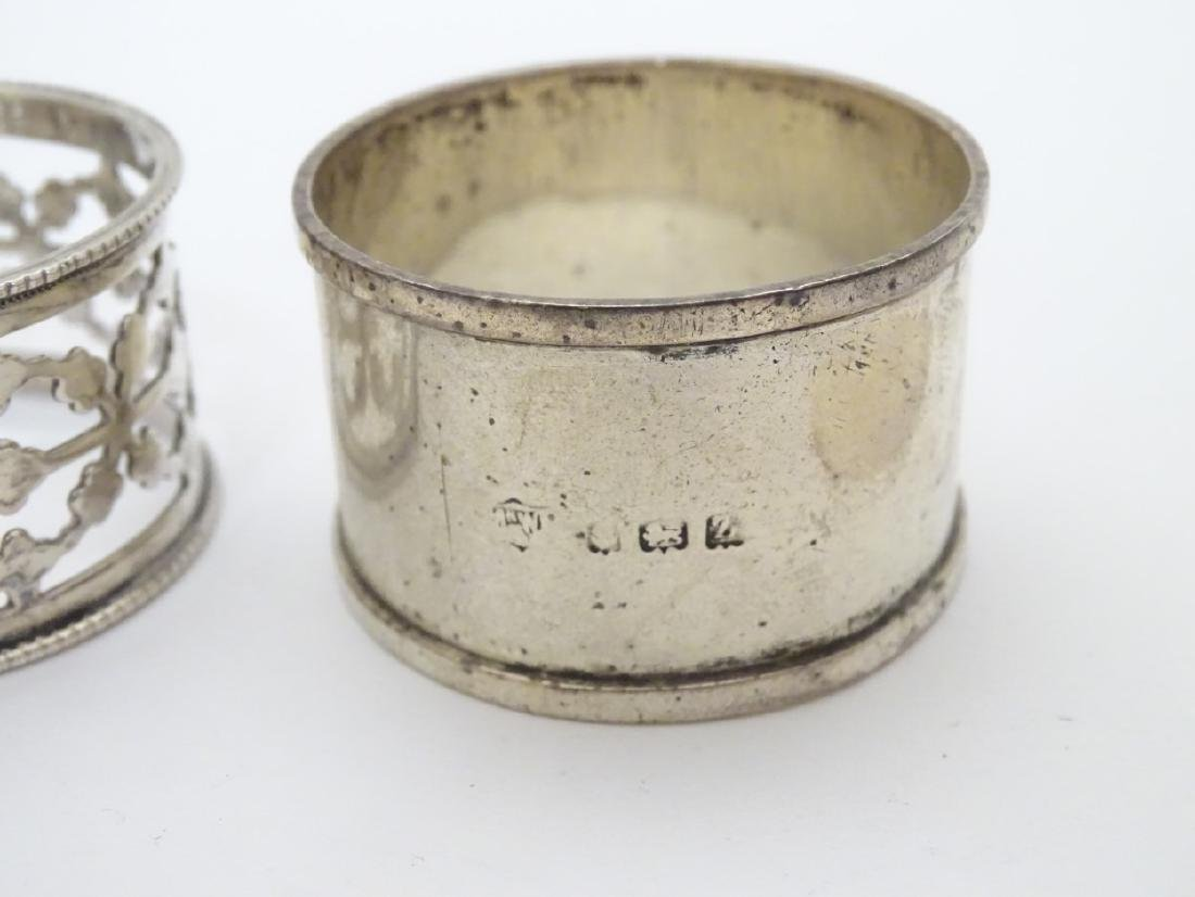 4 assorted silver napkin rings including examples - 4