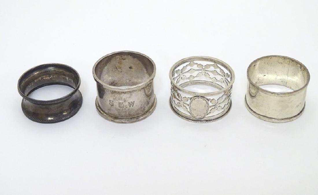 4 assorted silver napkin rings including examples - 8