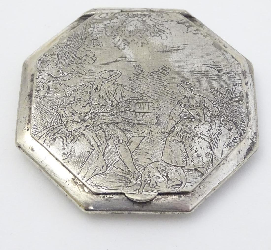 A silver plate powder compact of octagonal form with