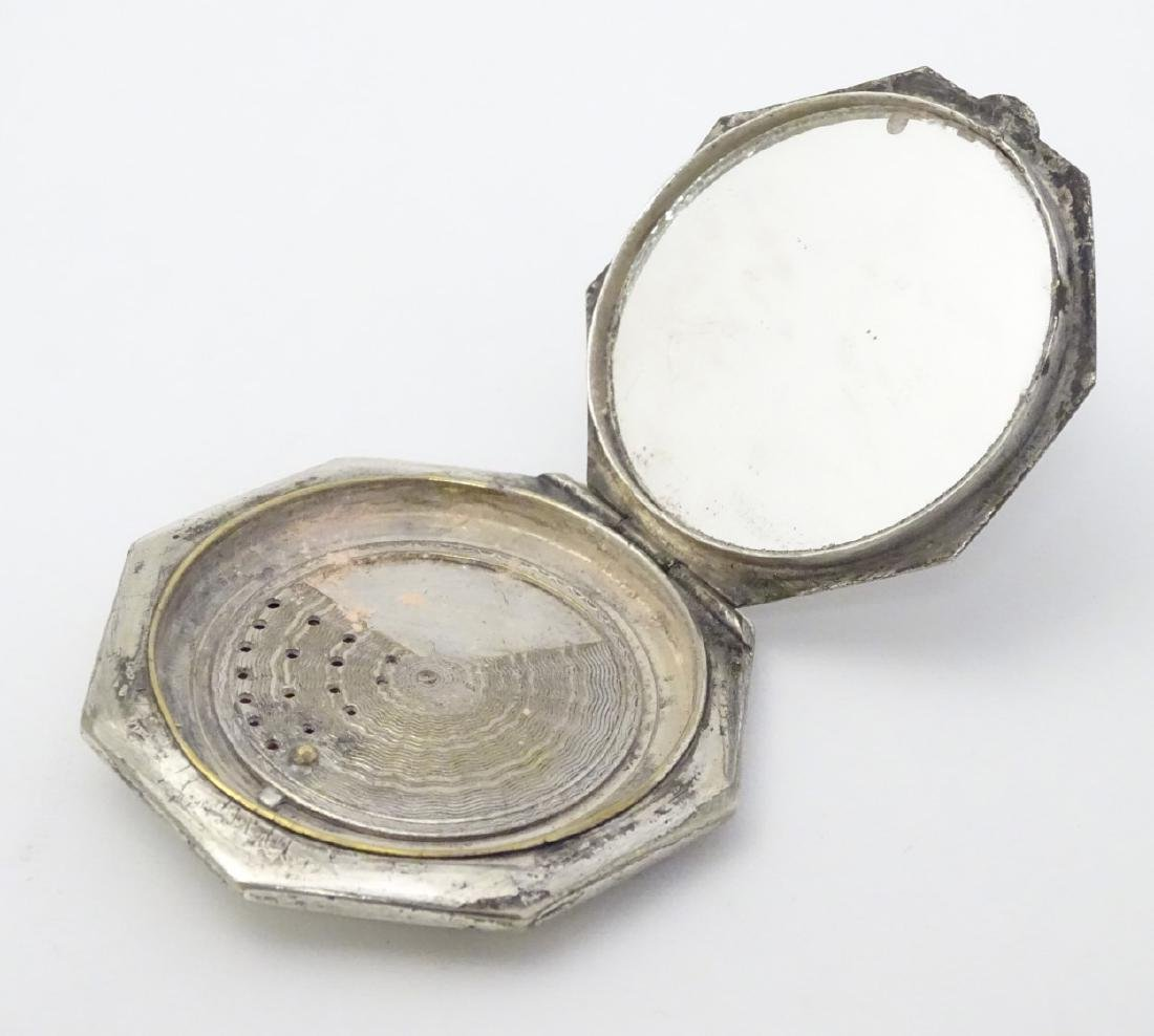 A silver plate powder compact of octagonal form with - 4