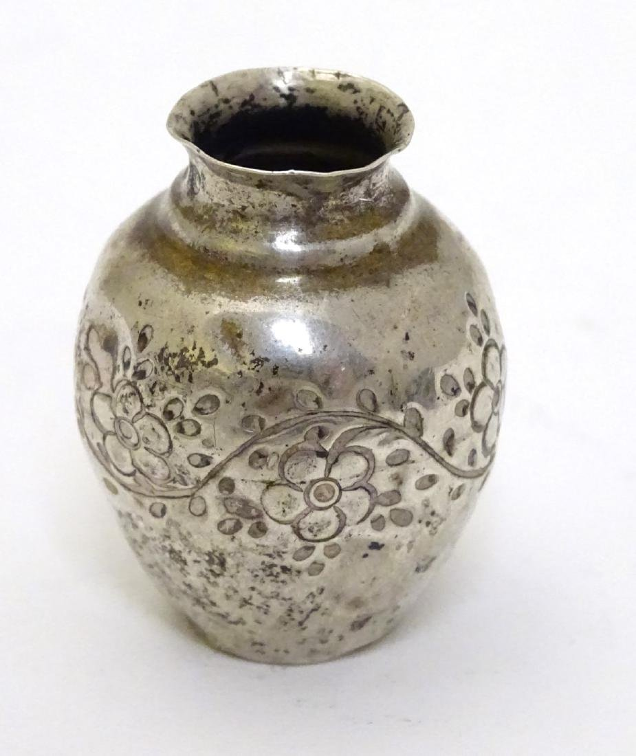 A Continental white metal miniature vase with floral