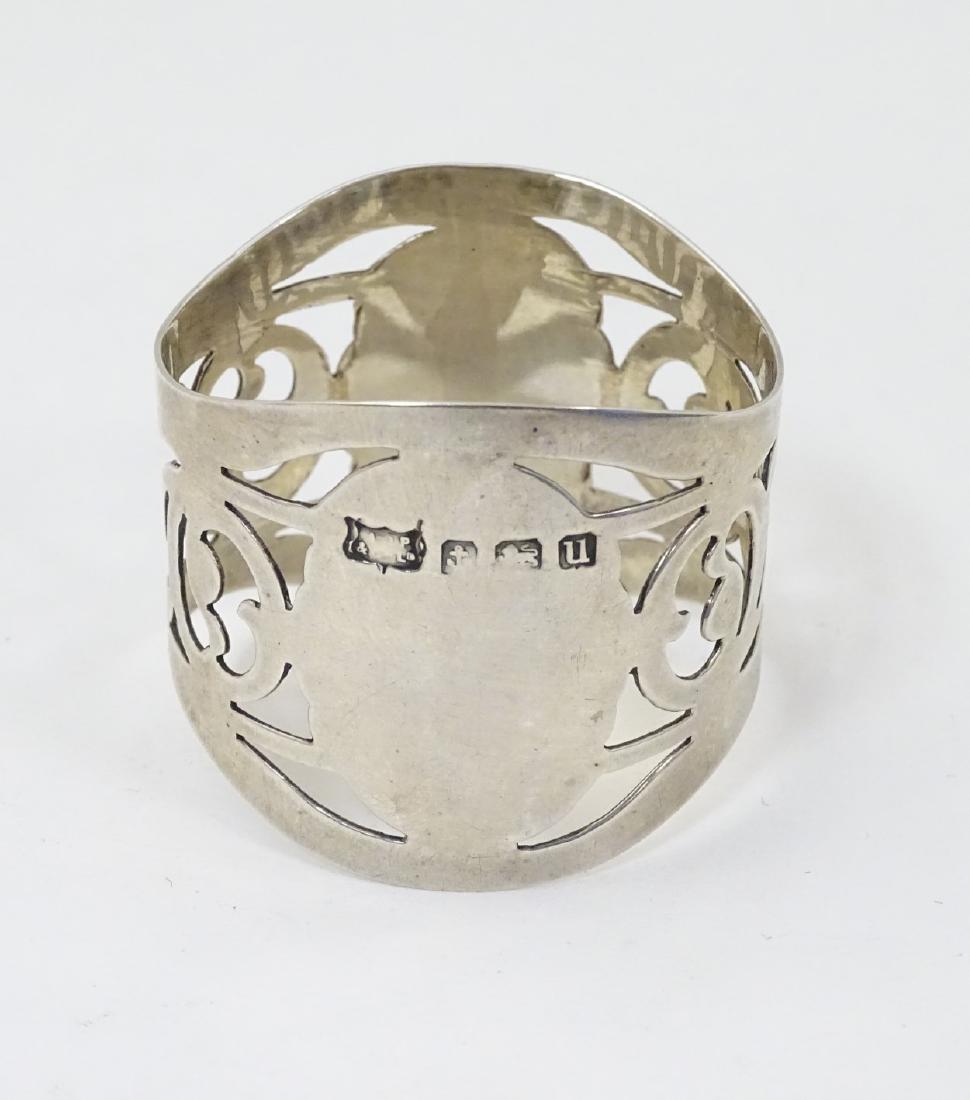 A silver napkin ring hallmarked Birmingham 1919 maker A