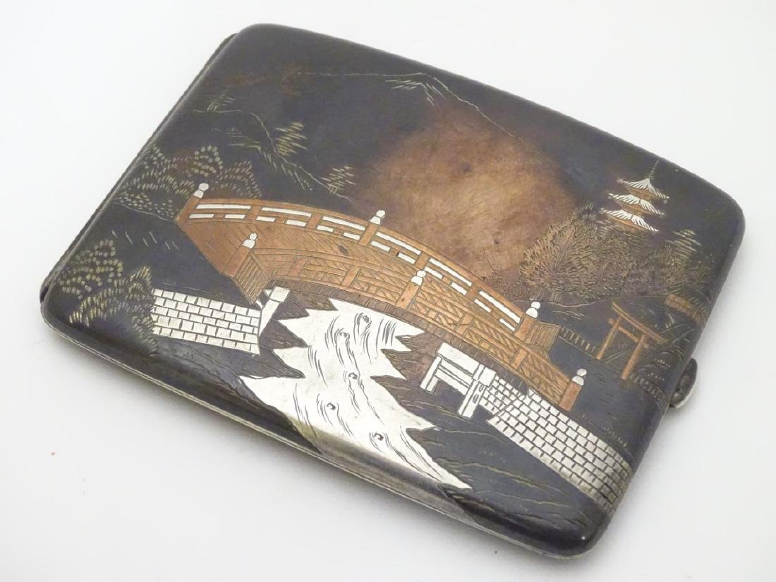 A vintage Japanese Amita ware cigarette case with