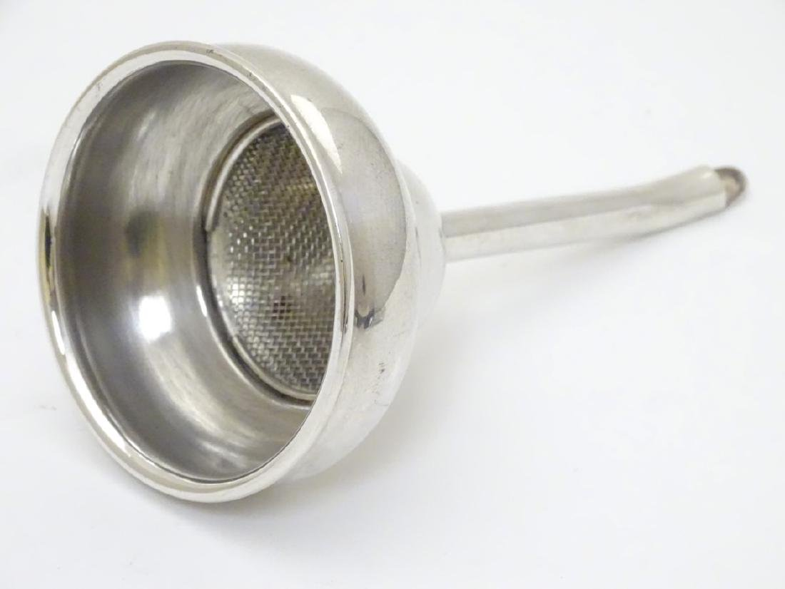 A silver plated wine funnel 5 1/2'' long x 3'' wide