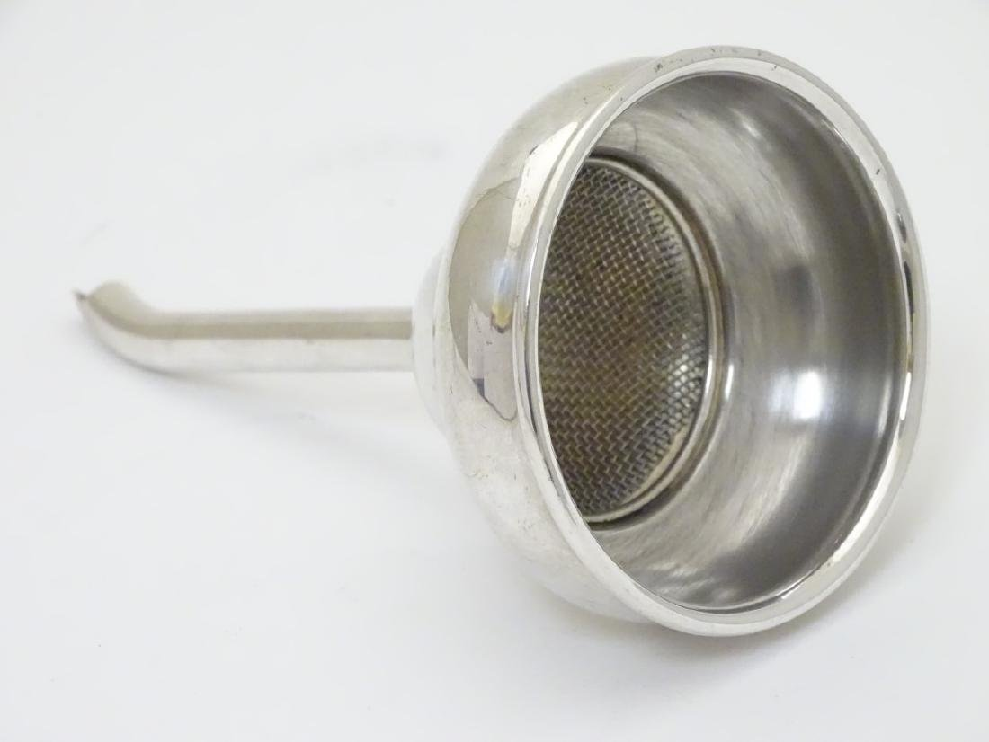 A silver plated wine funnel 5 1/2'' long x 3'' wide - 3