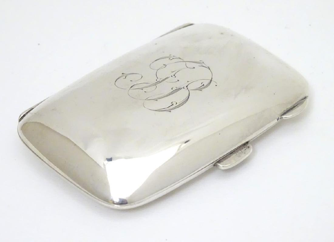 A silver cigarette case hallmarked Birmingham 1924