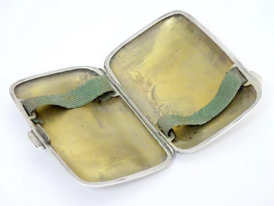 A silver cigarette case hallmarked Birmingham 1924 - 4
