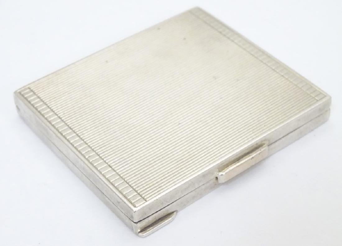 An Art Deco silver compact  of squared form. Hallmarked