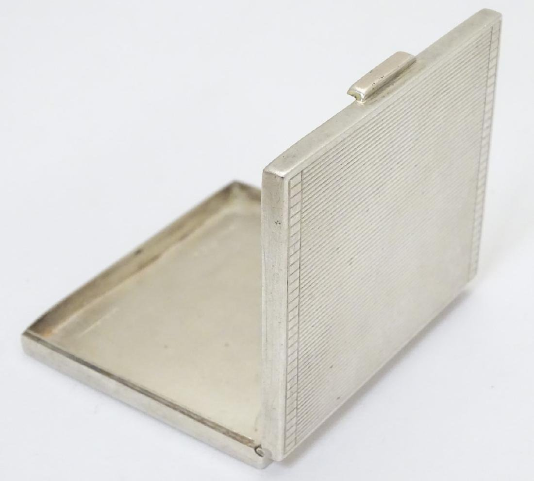 An Art Deco silver compact  of squared form. Hallmarked - 2