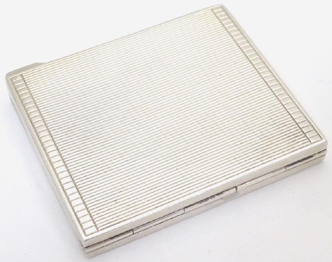 An Art Deco silver compact  of squared form. Hallmarked - 4