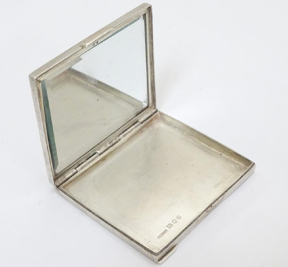 An Art Deco silver compact  of squared form. Hallmarked - 5