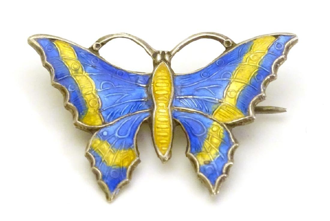 A  Silver brooch formed as a butterfly with enamel
