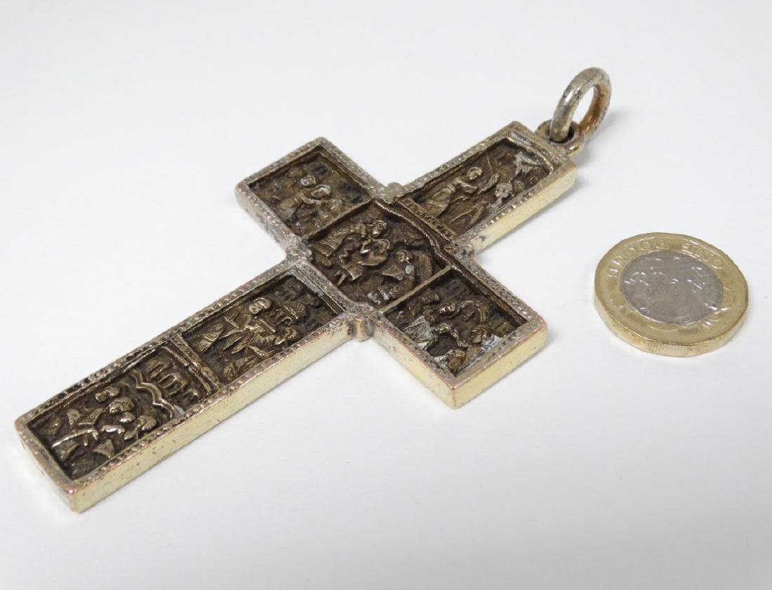A white metal cross / crucifix  with cast religious