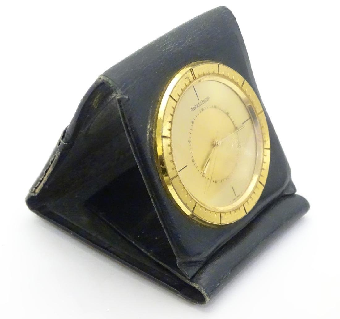 Jaeger-Le-Coultre : a green leather cased folding purse