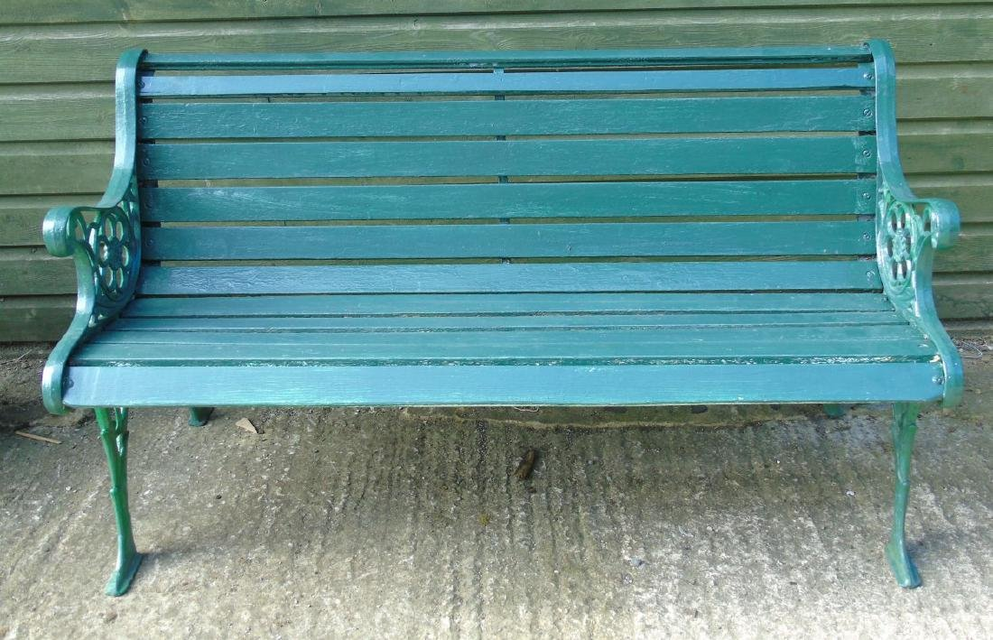 Garden bench : A 2 1/2 seat green painted bench with