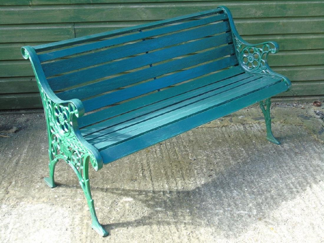 Garden bench : A 2 1/2 seat green painted bench with - 2
