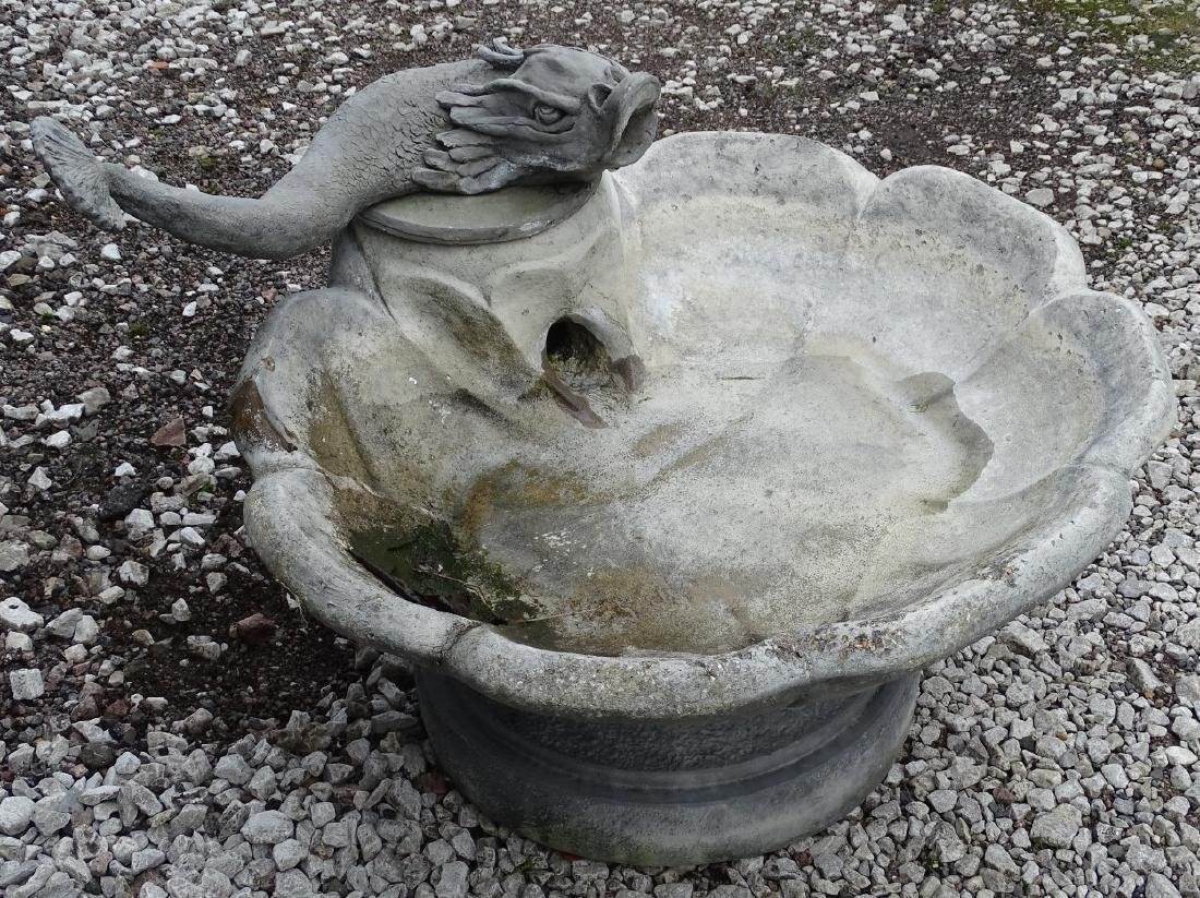 A greyed fiber glass antique style garden fountain with