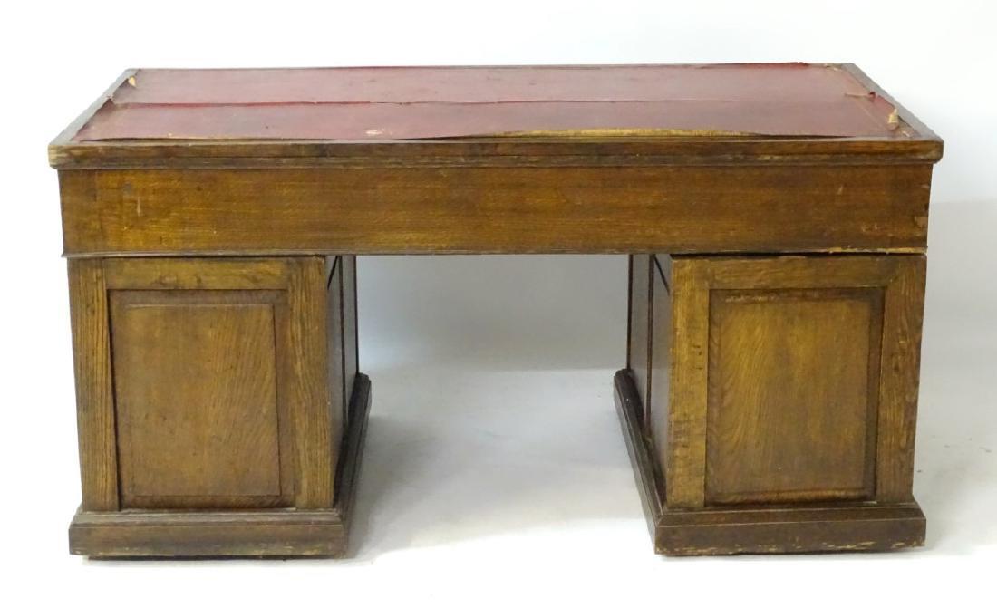 An early 20thC oak pedestal desk comprising a single - 2