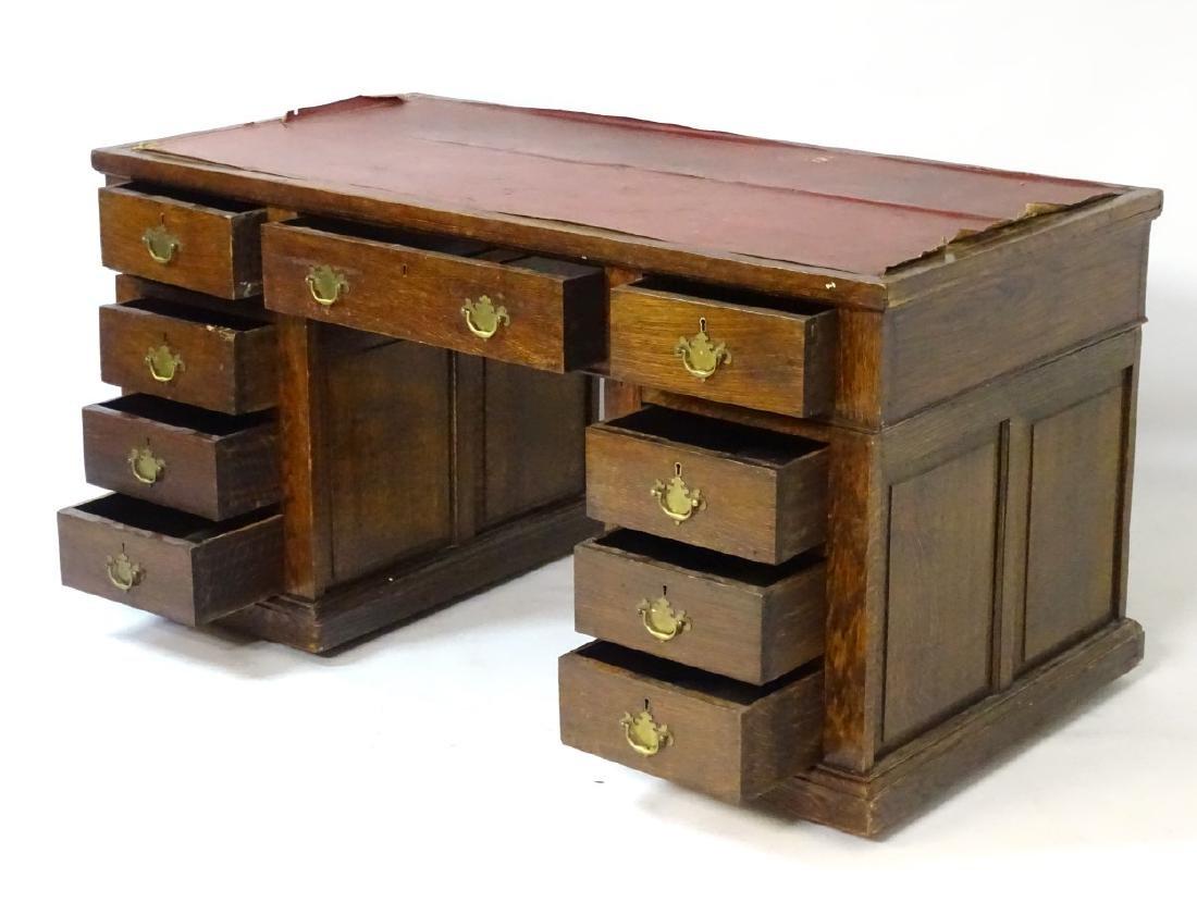 An early 20thC oak pedestal desk comprising a single - 7