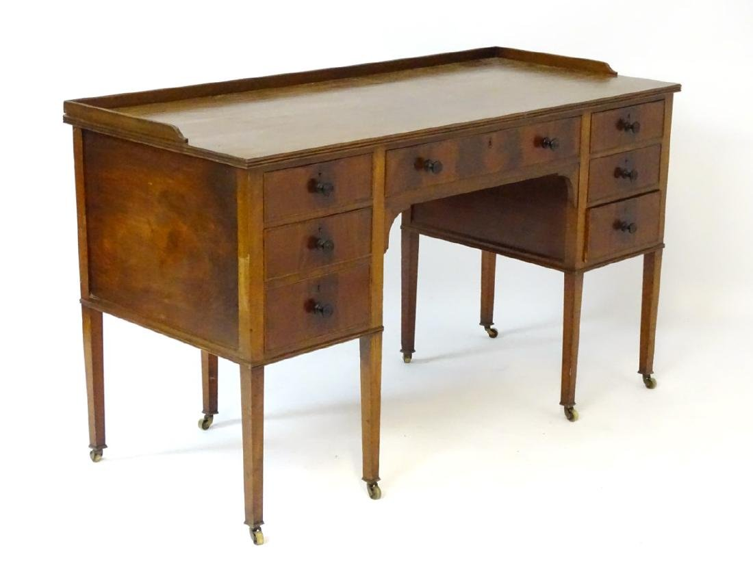 An early / mid 20thC mahogany desk / writing table with