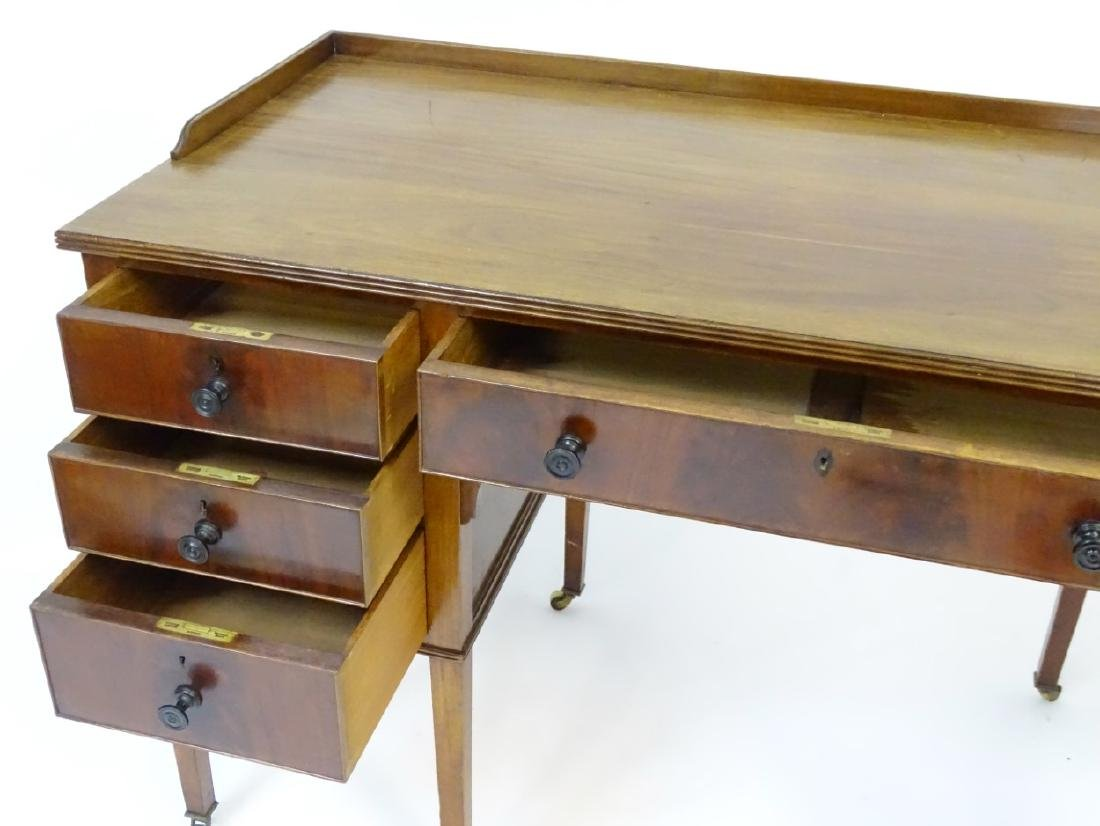 An early / mid 20thC mahogany desk / writing table with - 2
