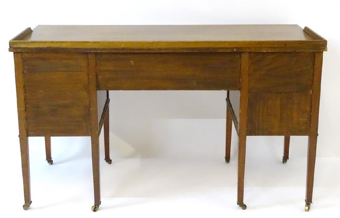 An early / mid 20thC mahogany desk / writing table with - 3