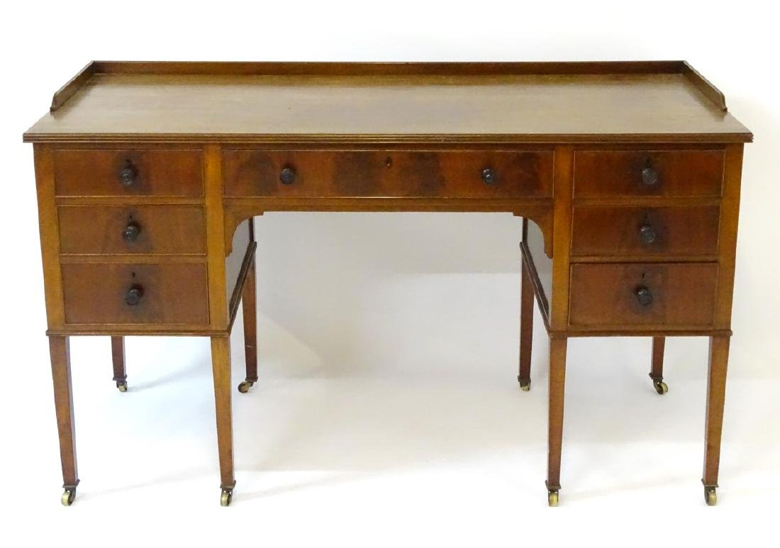 An early / mid 20thC mahogany desk / writing table with - 4