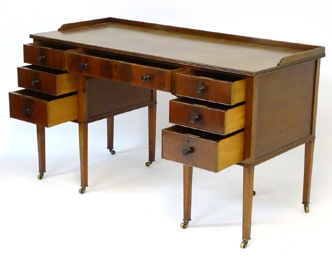 An early / mid 20thC mahogany desk / writing table with - 6