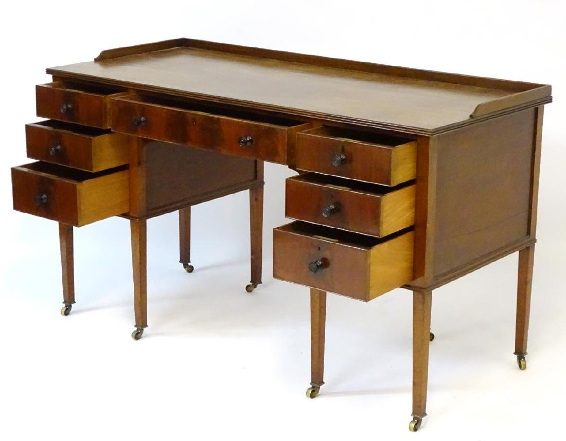 An early / mid 20thC mahogany desk / writing table with - 7