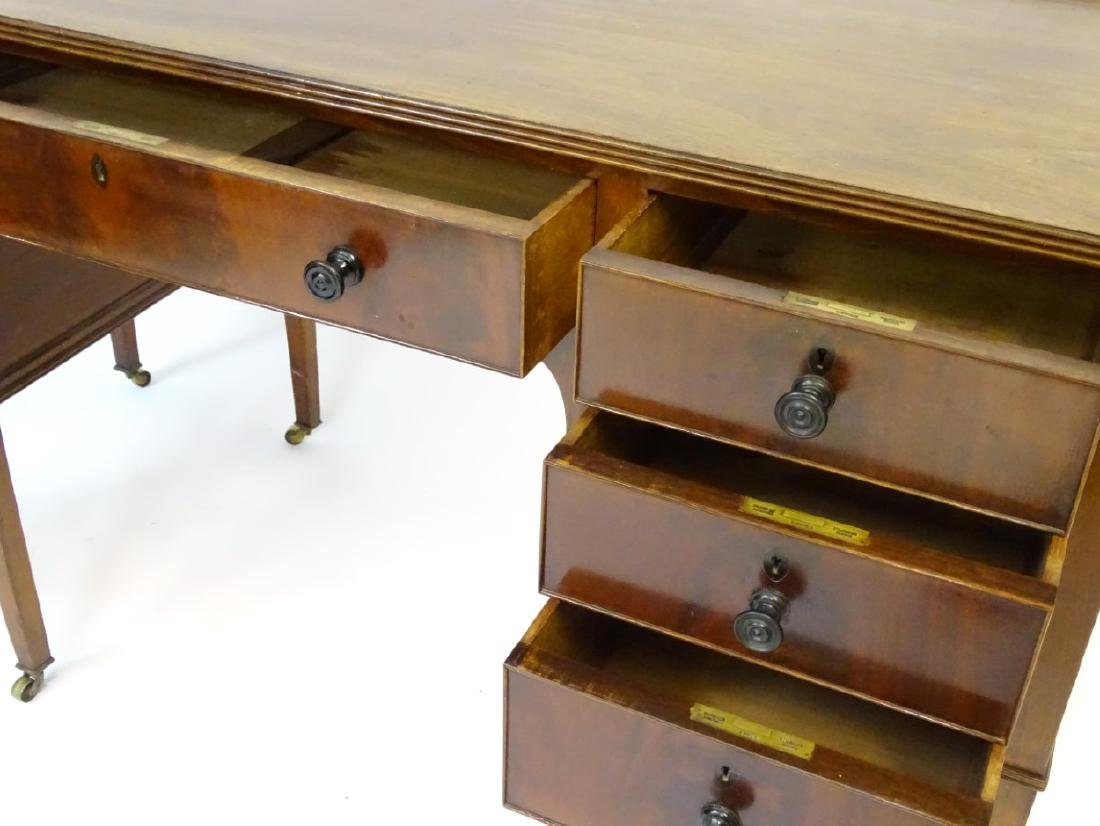 An early / mid 20thC mahogany desk / writing table with - 8