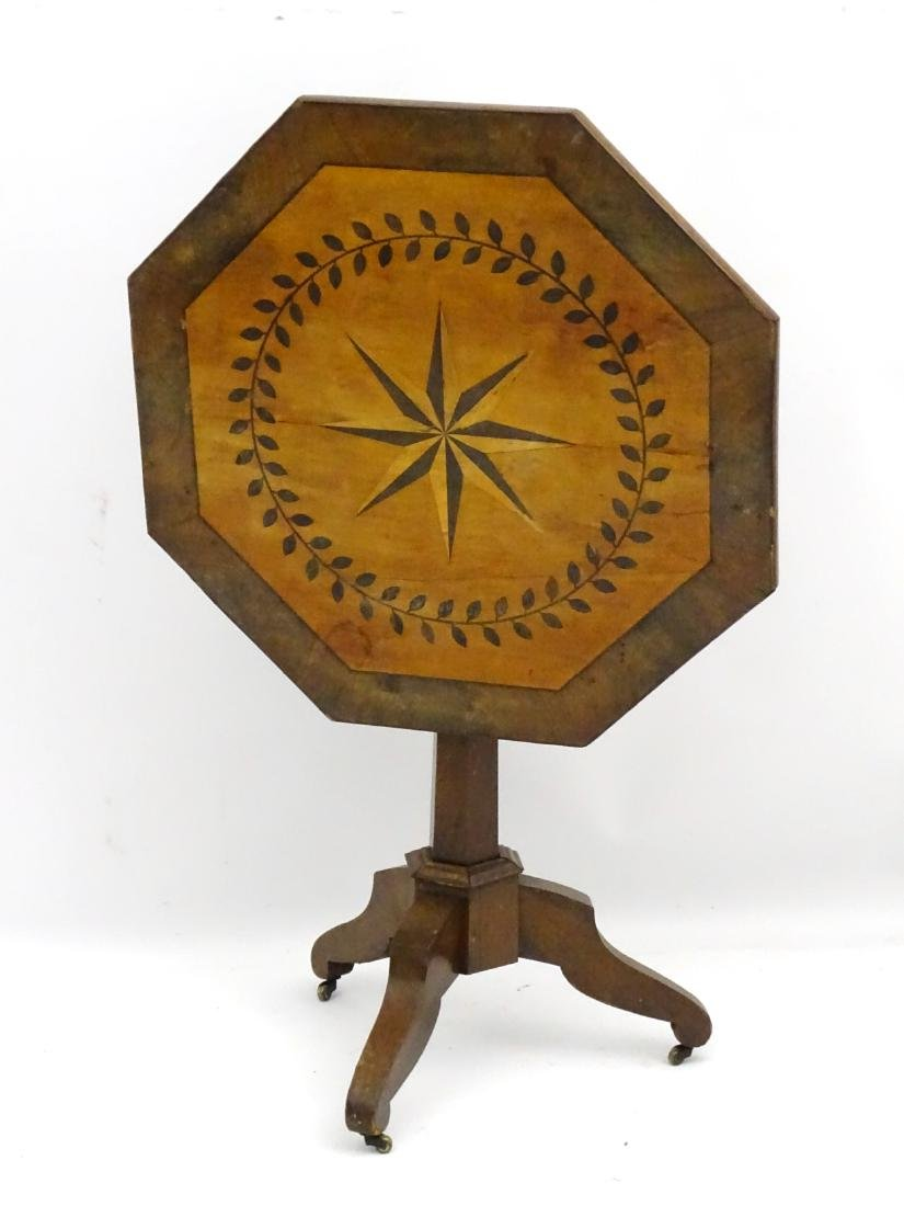 A late 19thC mahogany octagonal tilt top table with