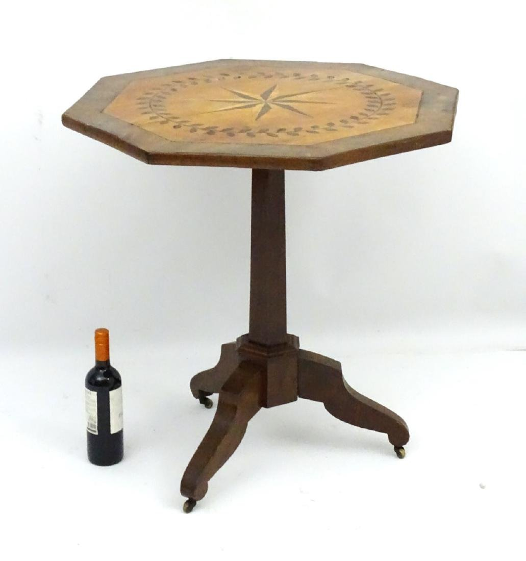 A late 19thC mahogany octagonal tilt top table with - 3