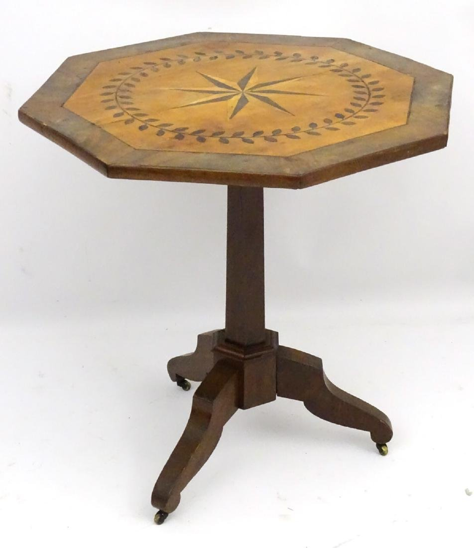 A late 19thC mahogany octagonal tilt top table with - 4