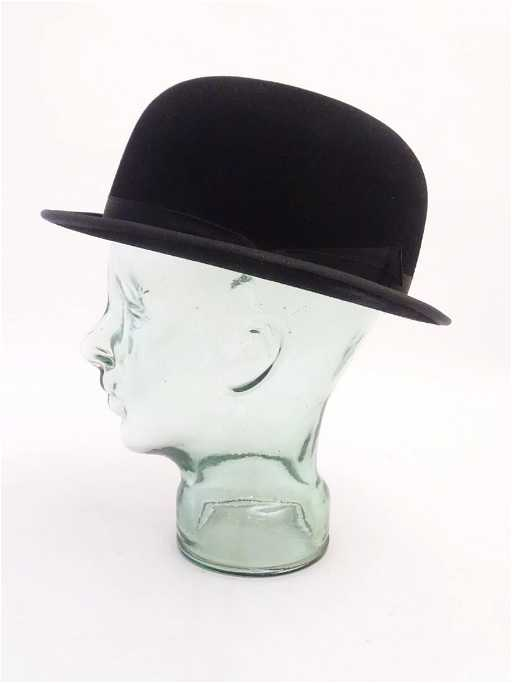 fa65711f95dc78 A Christys' (London), black felt bowler riding hat with